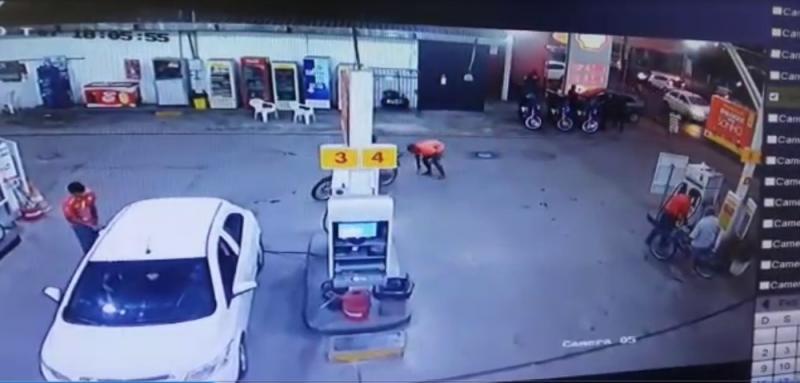 Suspeito é preso ao deixar arma cair em posto de combustíveis
